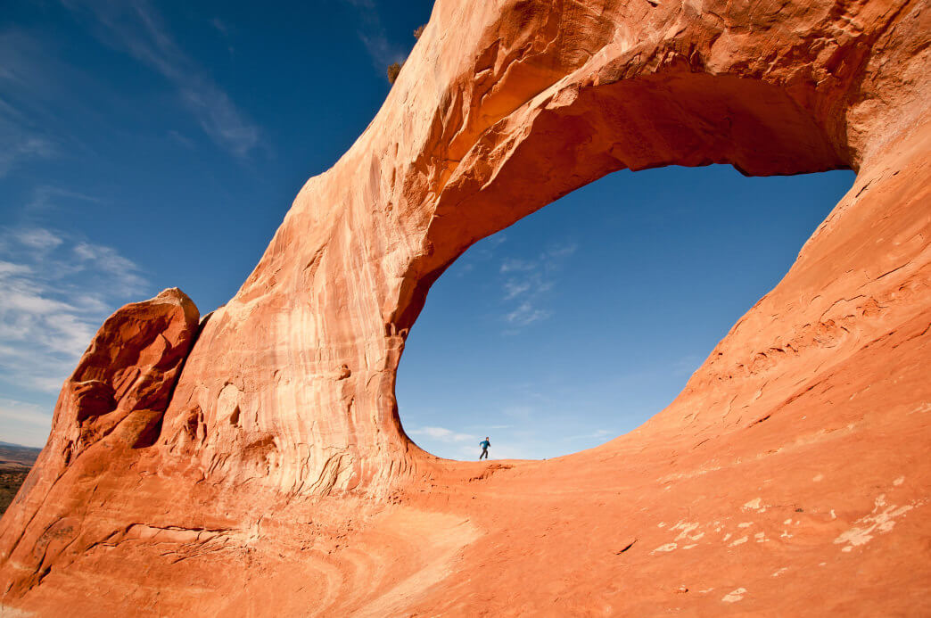 Running under a formation Arches National Park