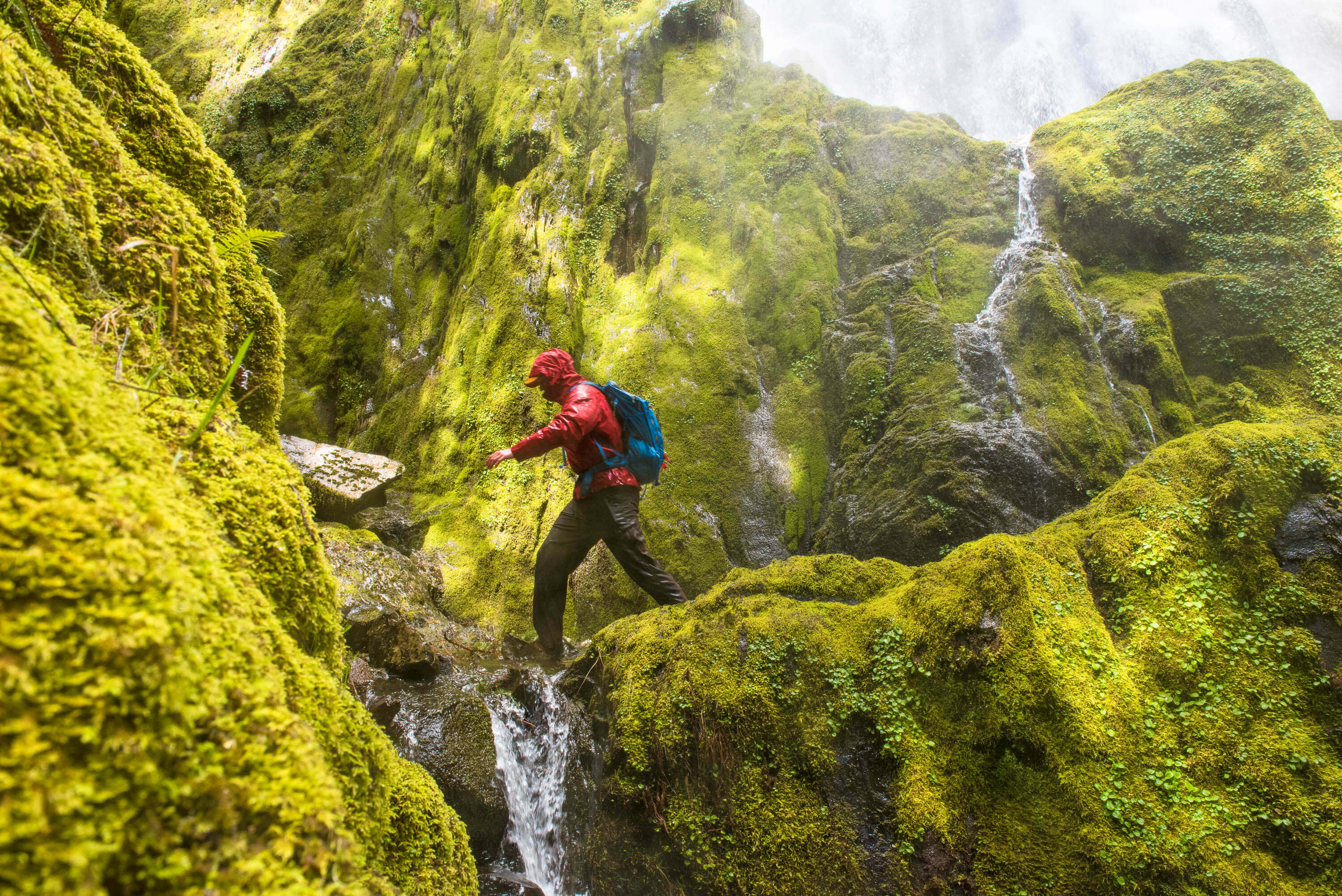 Waterfall spray, moss covered rocks and Lief on a micro adventure