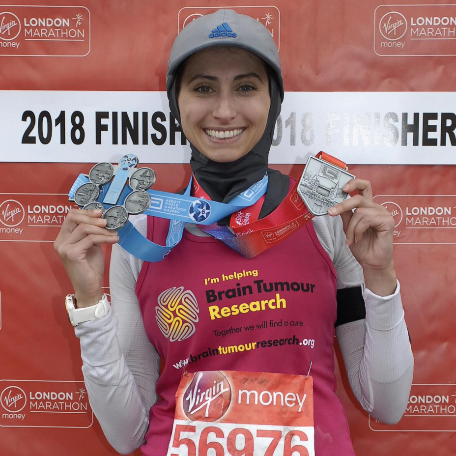 Earning a finisher's medal at the London Marathon despite challenging circumstances