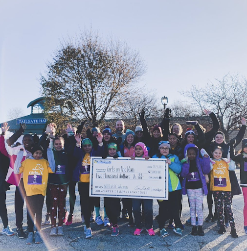 September 2019: Performance Running Outfitters donated a portion of sales to Girls on the Run of Southeastern, WI and staff volunteered as a cheer square for their annual 5K run.