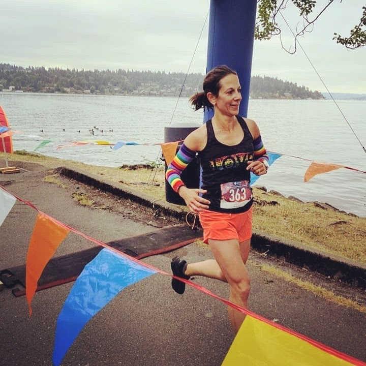 Superfeet Ambassador Christine McHugh crosses the finish line
