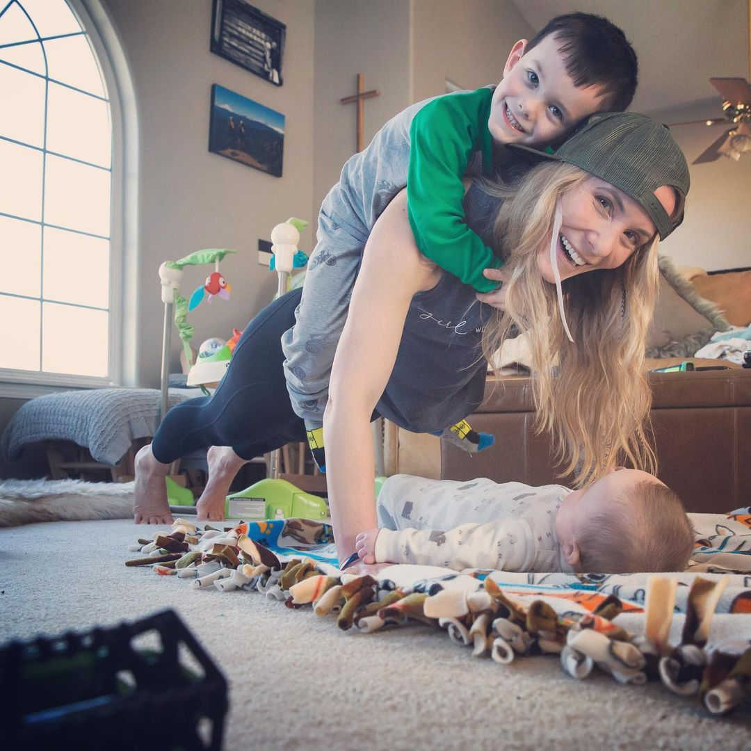 Shannon Mahre getting her workout in with help from her kids