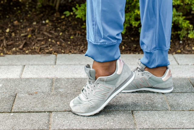 New Balance lifestyle sneakers, shown here in gray, are a great choice for moms on the go.