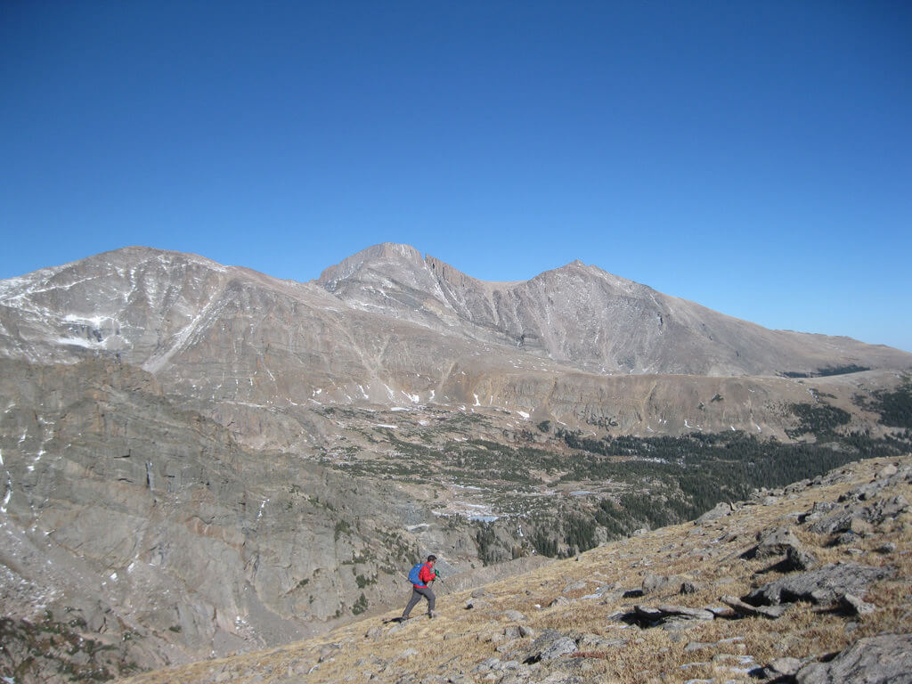 En route to Boulder Grand Pass with Longs Peaks (center) and Mount Meeker (right) in the background. James Dziezynski