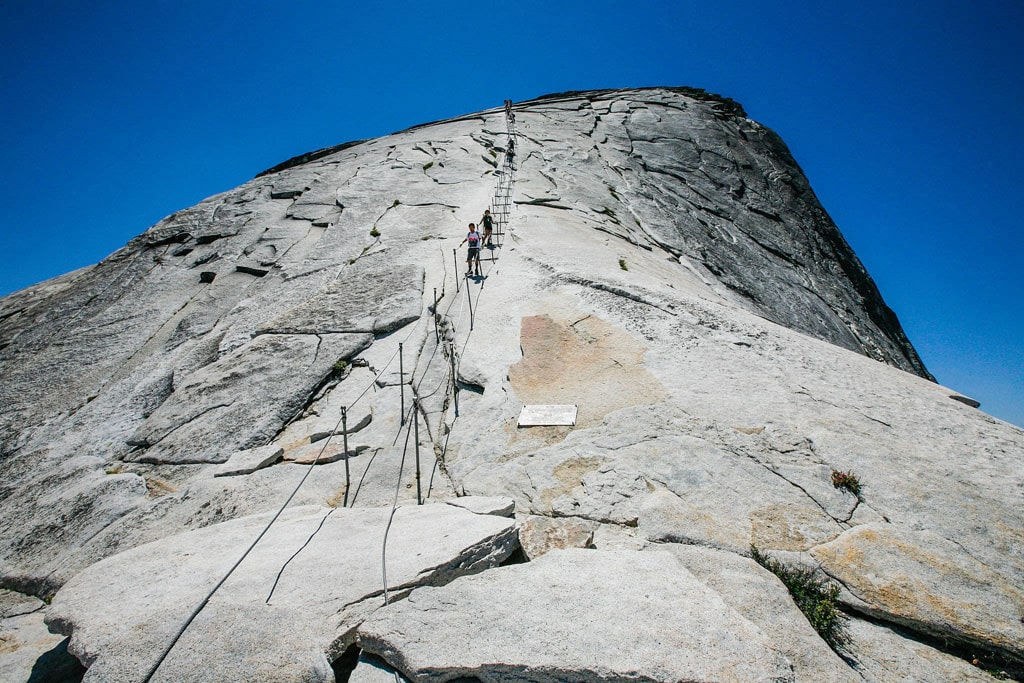 Start planning far in advance to snag a permit to summit Half Dome, one of Yosemite's most iconic landmarks. Alex Proimo